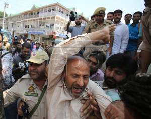 epa04865776 Indian police officers detain a Kashmiri legislator of the pro-India Awami Ittehad Party, Abdul Rashid Sheikh (C), during a protest in Srinagar, the summer capital of Indian Kashmir, 30 July 2015. Rashid stages a protest demonstration along with his dozen odd supporters against the hanging of 1993 Bombay serial bombing convict, Yakub Memon. Memon was hanged in Nagpur Central Jail at 7 am local time on 30 July 2015. He was accused of being one of the masterminds of the Bombay serial bombings along with top fugitive, Dawood Ibrahim and one of his own brothers, Tiger Memon. 257 people were dead and over 700 injured in the serial bombings on 12 March 1993.  EPA/FAROOQ KHAN